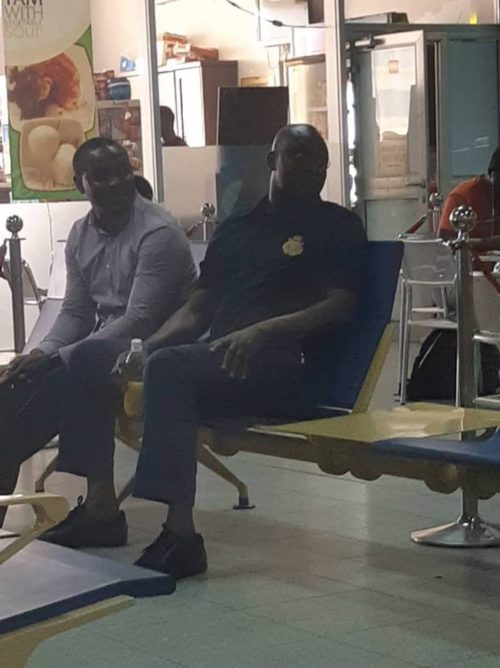 Fayose, right, and an EFCC operative at the Nnamdi Azikiwe Airport in Abuja on Sunday