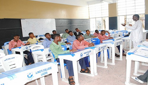 Kings-College-students-receiving-lesson-from-a-teacher