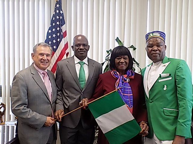 SENIOR COUNCILWOMAN REPRESENTING HEMPSTEAD MS DOROTHY GOOSBY WITH CONSUL-GENERAL OF NIGERIA IN NEW YORK, BENAOYAGHA OKOYEN FLANKED BY REV. DAVID KAYODE AND COUNCIL ATTORNEY JOSEPH RA-TOWN WHEN OKOYEN PAID A VISIT TO GOOSBY AFTER HER OFFICE HOISTED NIGERIAN FLAG AT THE HEMPSTEAD TOWN HALL IN NEW YORK