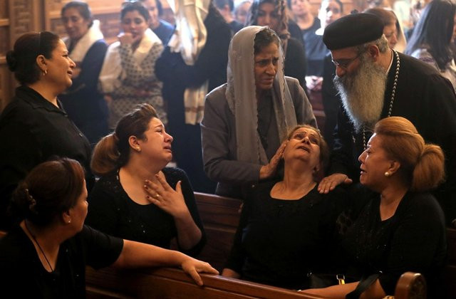 Some Christians in Egypt weep uncontrollably as 7 dead members killed in militant attack are buried. 6 of the dead from same famili