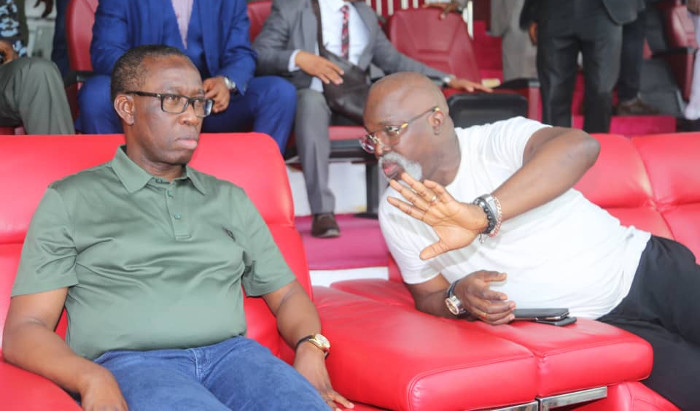 Gov Okowa with NFF President Amaju Pinnick conversing while watching the Super Eagles training