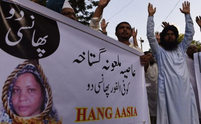 Protesters want Asia Bibi hanged as lawyer flees to Europe