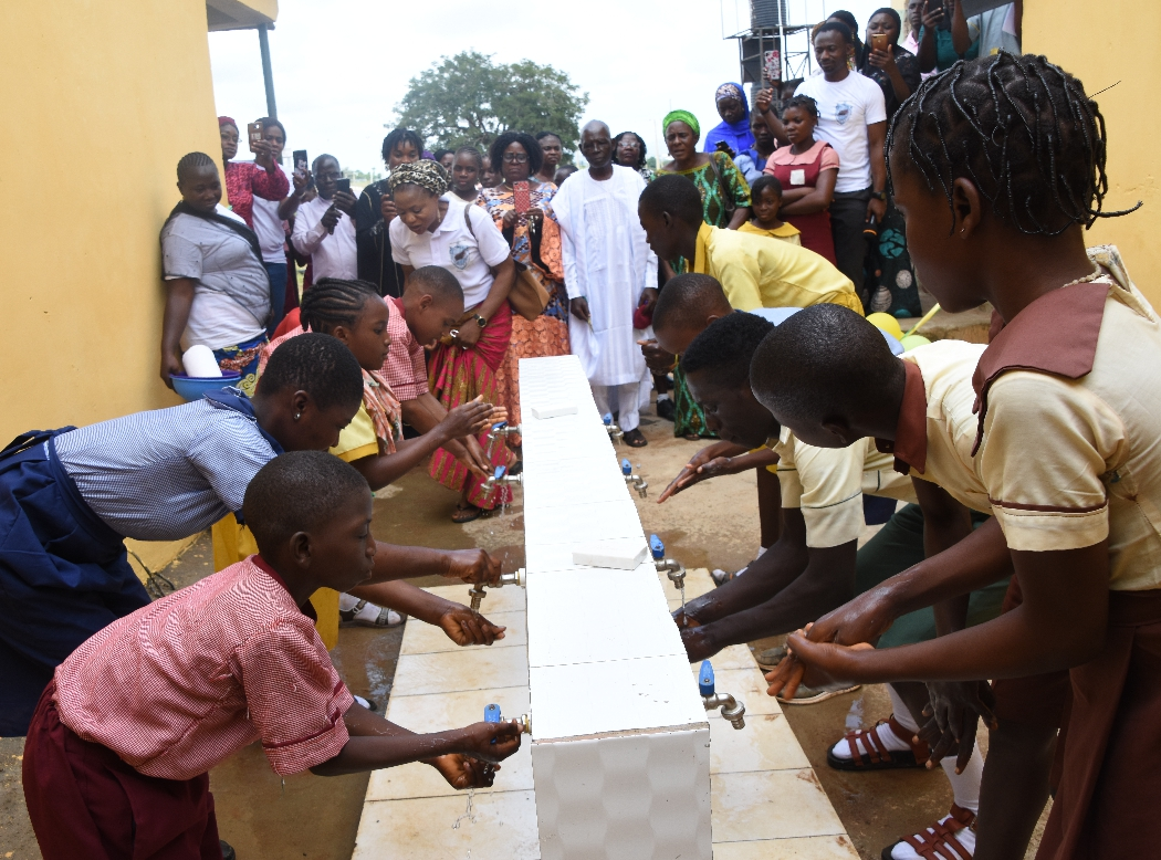 Students of some primary schools along Airport Road, Abuja during the 2019 Hand washing Day